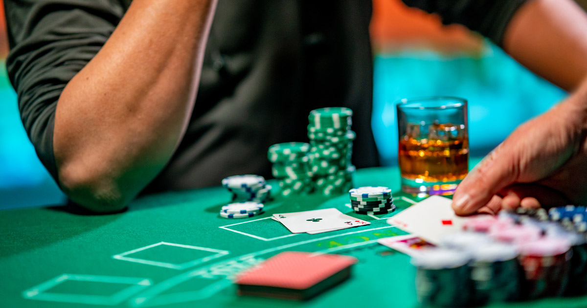 man playing cards at a casino table
